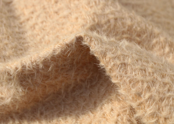 Porridge 11 mm quite sparse, wildly distressed, mohair for teddy bears with a soft, pale peachy cream pile and backing. It's a great mohair for smaller traditional teddy bears, or larger bears, good for cute happy bears, or ,with some shading, teddies that you want to look old and loved.