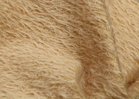 Shortcake 12 mm quite sparse, distressed (ratinee) mohair for teddy bears with a soft beige pile and backing This has a moderately short, distressed, fairy sparse, beige pile and a slightly warmer beige backing, which helps make your bear's face stand out a little.  It's a great colour for smaller traditional teddy bears, or larger bears that you want to look old and loved.
