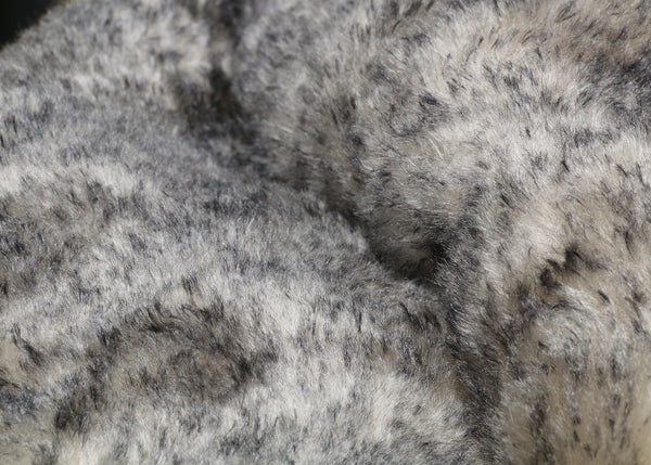 Smoked Truffle 25 mm (one inch) charcoal tipped cream, dense, distressed mohair for teddy bears with a cream backing Smoked Truffle is a gorgeous charcoal-tipped cream mohair with a soft and fluffy 1 inch pile. It's a great colour and texture for medium and large teddy bears. The backcloth is also cream meaning that if you trim the snout of your bear it will have a cream snout and an interesting smoky colouring.