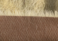Wholemeal Spaghetti is a blond gold mohair with hint of green and a soft and fluffy pile, its backing is a dull brown this means that your bear will have contrasting brown facial features when you trim the snout.