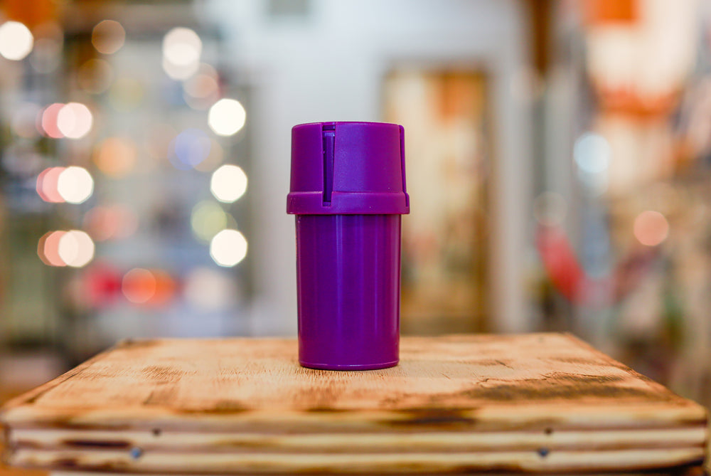 Purple Med-Tainer smell proof plastic grinder