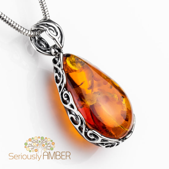 and a amber in green pendant silver setting