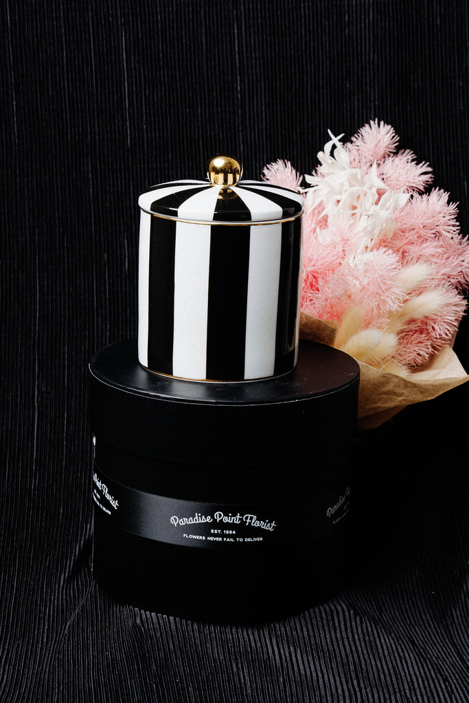 Cristina Re Design exclusive ebony stripe soy candle accentuated with bouquet of preserved flowers