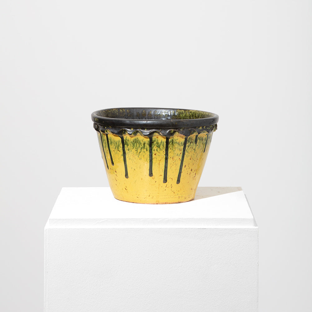 Yellow flowerpot with drips