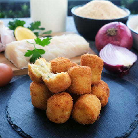 Bacalao croquetas with onion, parsley, garlic, egg, breadcrumbs, milk.