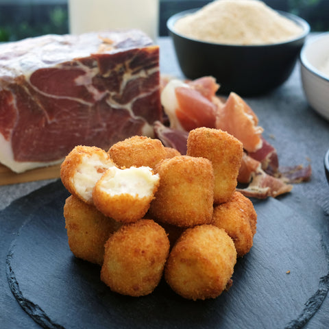 Jamon serrano croquetas with breadcrumbs, milk, flour.