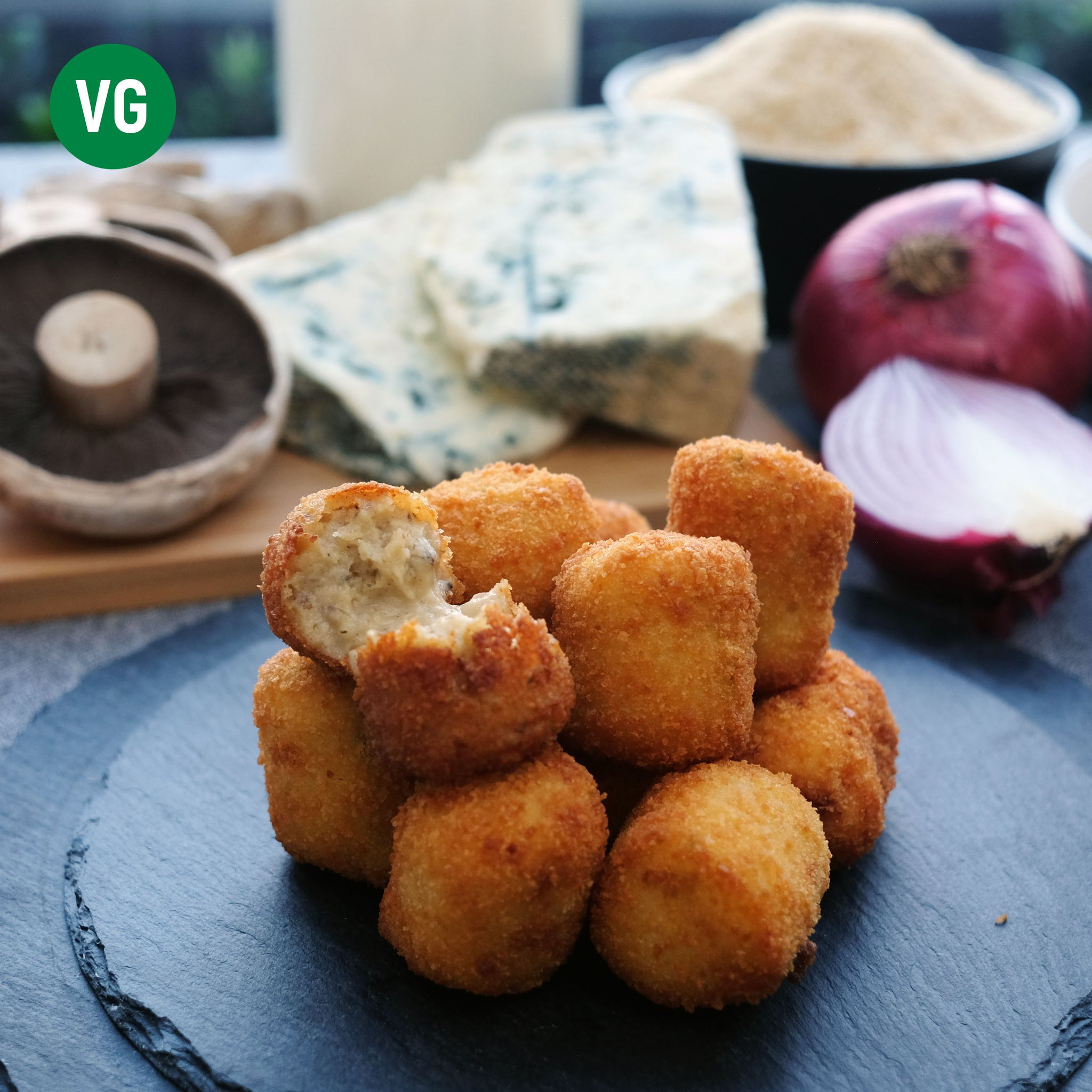 Mushrooms, blue cheese croquetas with onion, breadcrumbs, milk.