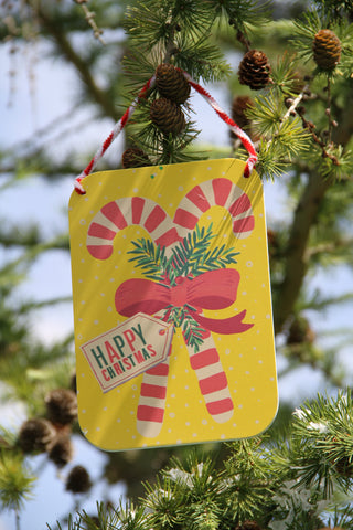 Double Red Stripe Candy Cane on Yellow Wooden Sign.