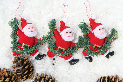 Set of Three Vintage Flock Santa Decorations.