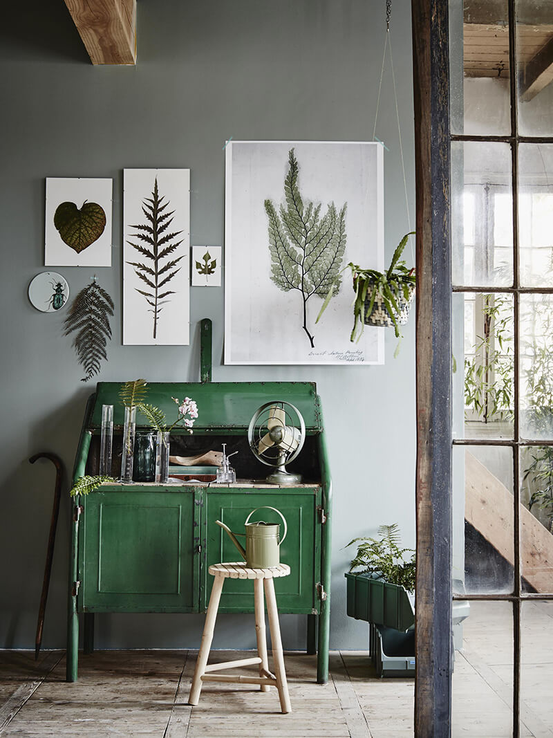 Botanical posters with a beautiful green side cabinet.