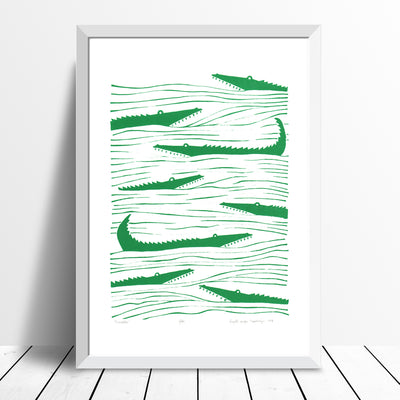 Graphic emerald green patterned art print of crocodiles lurking in the waters. Inspired by the simple shapes of animals found in African wood carvings.