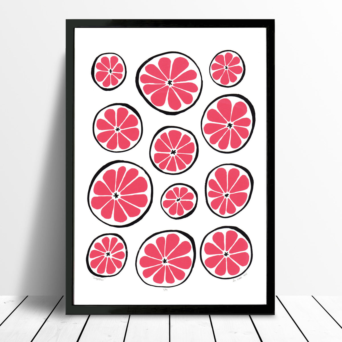 Bright and vibrant print of zesty grapefruits in bold ruby red. This playfully patterned citrus fruit print with a midcentury edge will brighten up your kitchen.