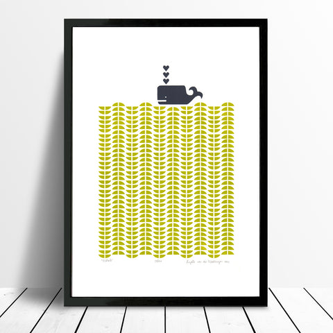 Nautical Scandinavian style print of a dark grey whale in a graphic sea of chartreuse green waves.