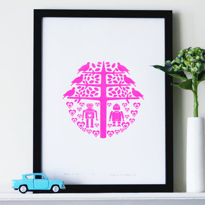 Quirky and bright limited edition wall art with a pair of nerdy little retro style robots in love in neon pink. A witty and charming gift with a romantic twist.