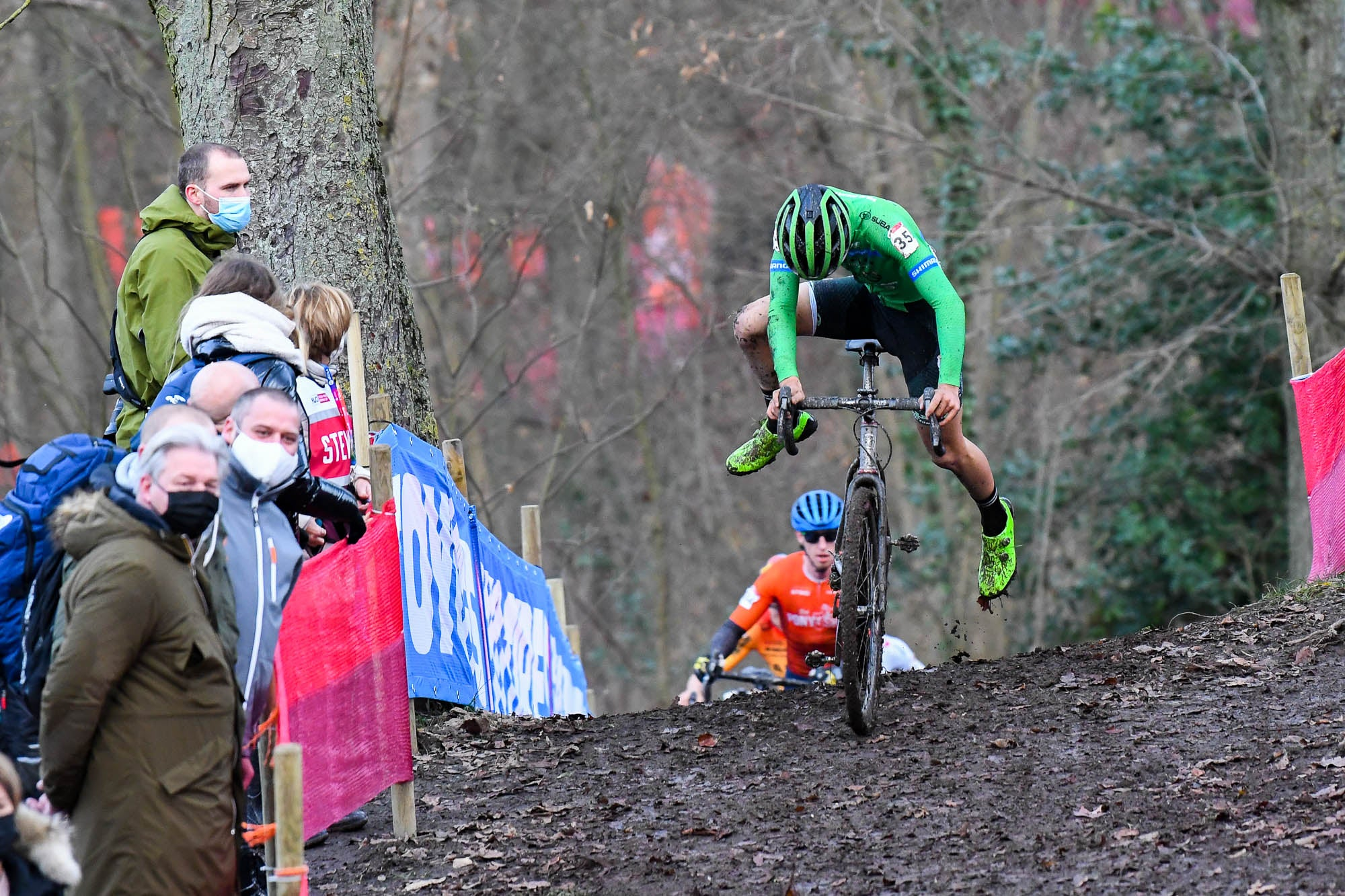 Hoping back on the back in Cyclocross race