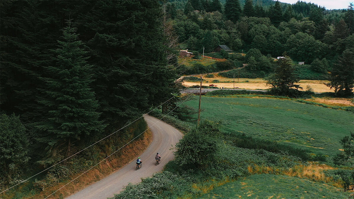 Aerial view of Kailey and Marley bikepacking on the Oregon Coast. All Bodies on BIkes
