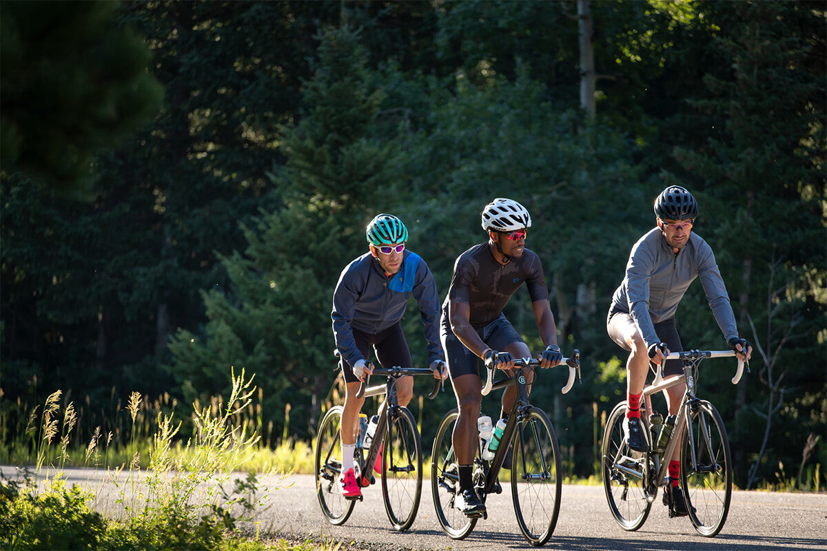 Group of friends riding gravel bikes and wearing Lazer bike helmets