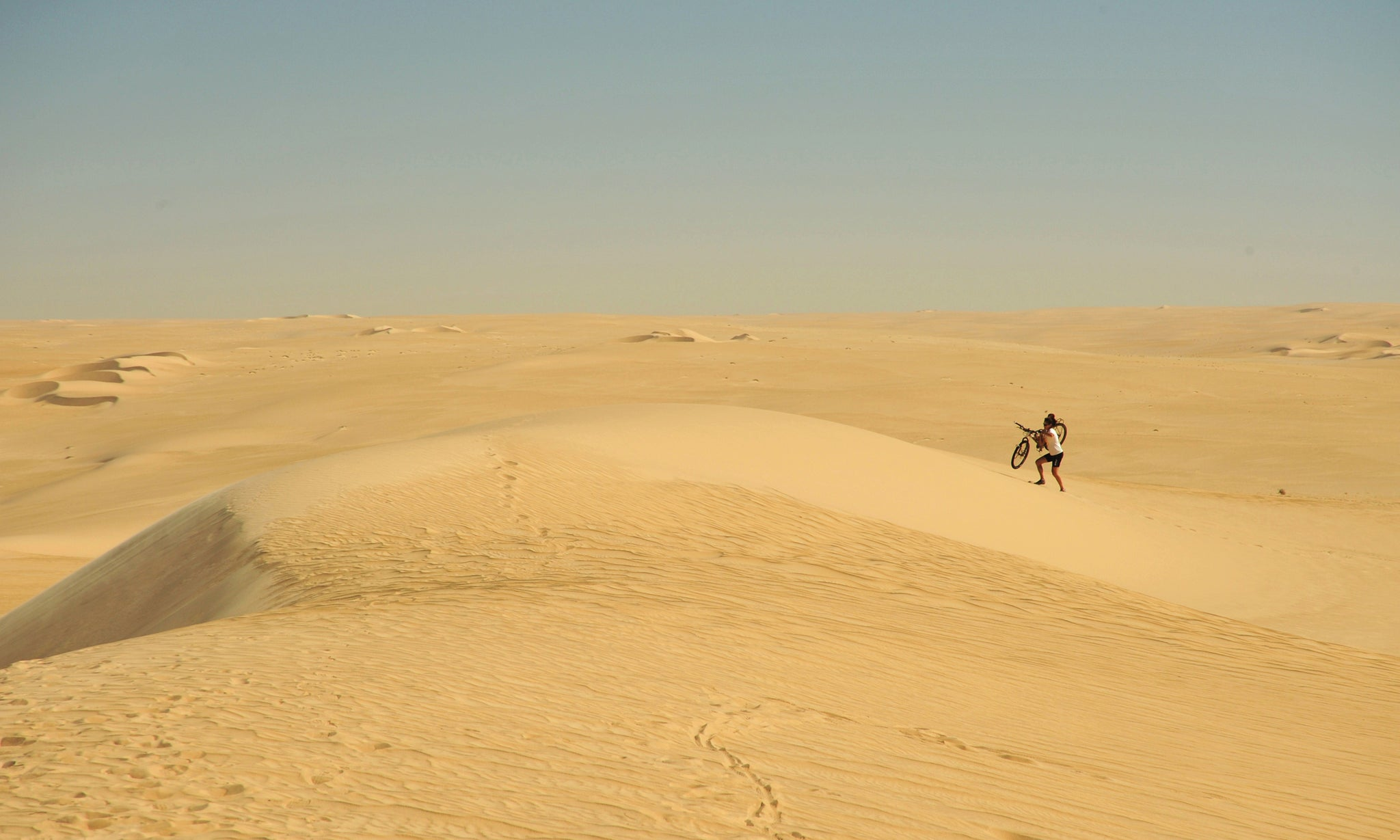 Hiking up the sand dunes