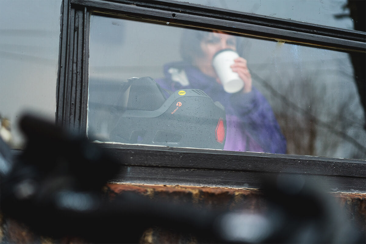 Women enjoying a cup of coffee after a wet rainy ride while wearing a Lazer Urbanize MIPS Helmet