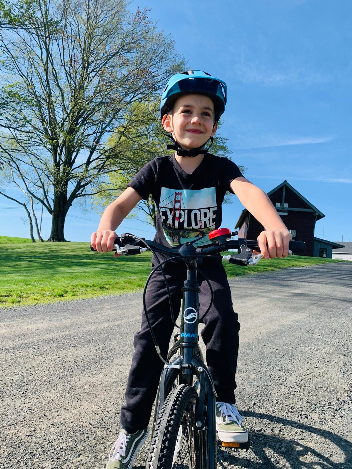 Young Kid riding his bike with a Lazer bike helmet
