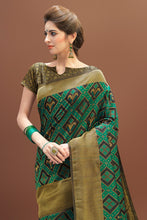 Load image into Gallery viewer, Bhelpuri Green and Gold Patola Saree with Brocade Blouse Piece