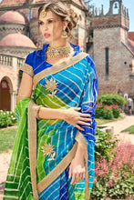 Load image into Gallery viewer, Bhelpuri Multi Colour Super Net Leheriya Saree with Blue Blouse Piece