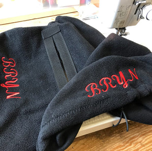 Embroidered ride on saddle cover