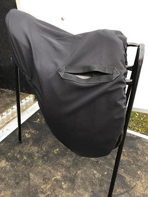 Black water resistant ride on saddle cover
