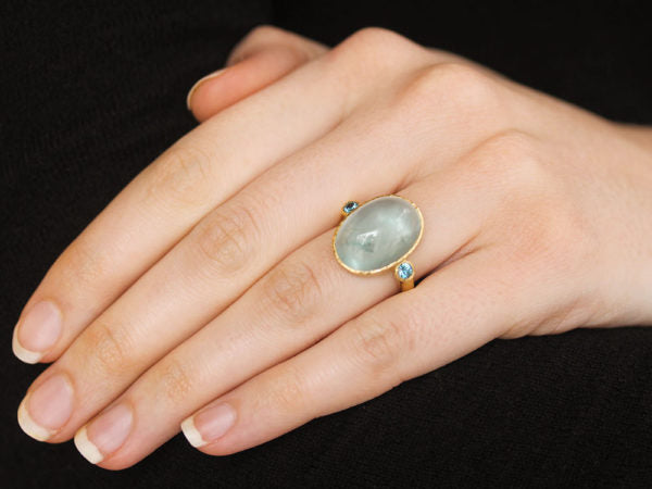 Oval Aquamarine Ring with Round Side Blue Zircons
