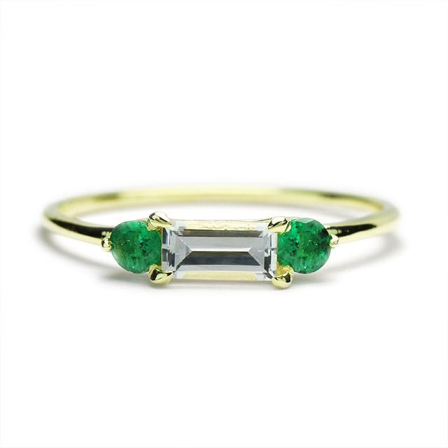 Petite ring with white sapphire and emeralds