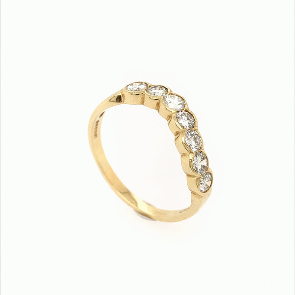 A wave of Diamonds in Yellow gold