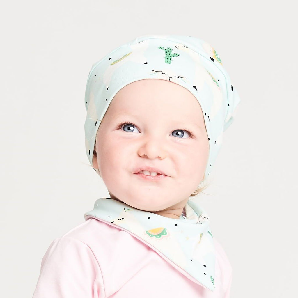 "Lined baby hat ""Alpakas Turquoise/Baby Pink"""