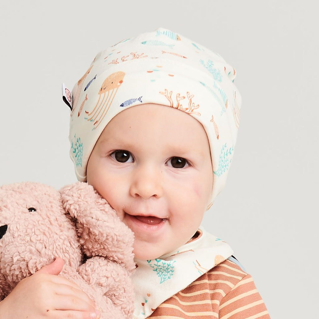 "Organic lined baby hat ""Ocean Party"" made from 95% organic cotton and 5% elastane"