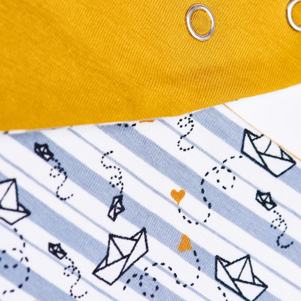 "Organic reversible dribble bib ""My little golden Ship"" made from 96% organic cotton and 4% elastane"