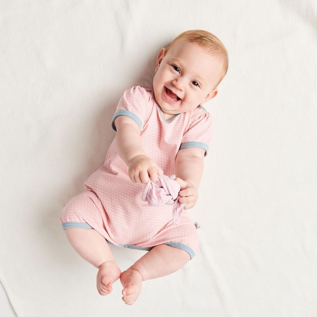 "Organic shortsleeve playsuit ""Kuller Peach Rose"" made from 95% organic cotton and 5% elastane"