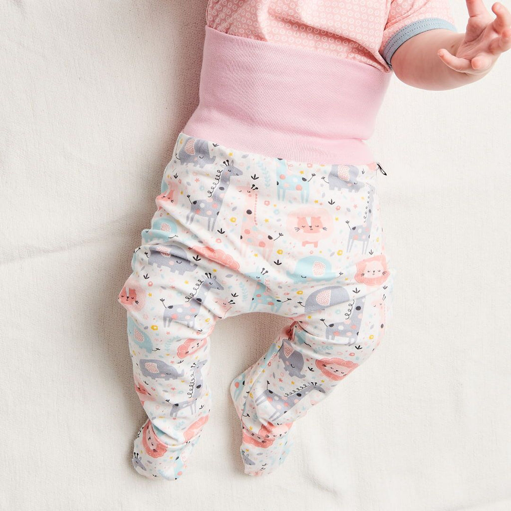 "Organic footed baby pants ""Kuller Peach Rose"" made from 95% organic cotton and 5% elastane"