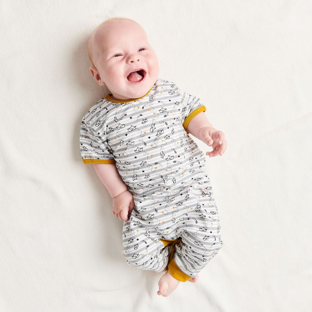 "Organic shortsleeved romper ""My little golden Ship"" made from 95% organic cotton and 5% elastane"