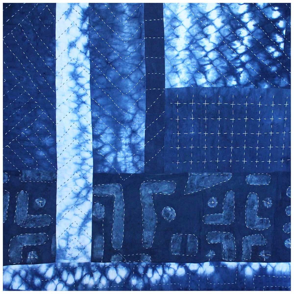 Detail of Indigo dyed patchwork quilt