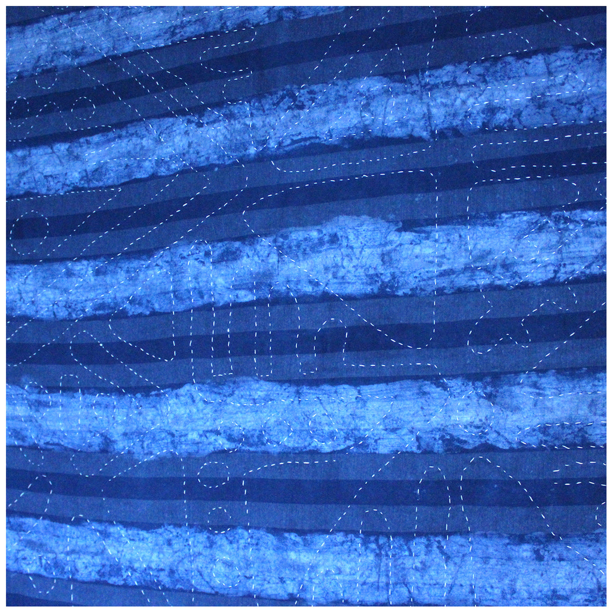 Detail of striped reverse of indigo dyed quilt