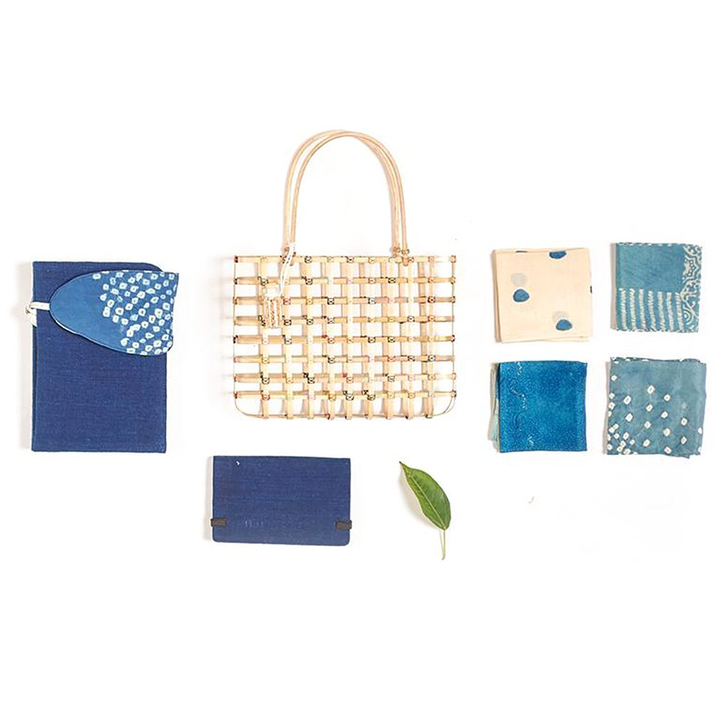 Bamboo essentials bag with indigo dyed diary and four handkerchiefs and indigo eye mask