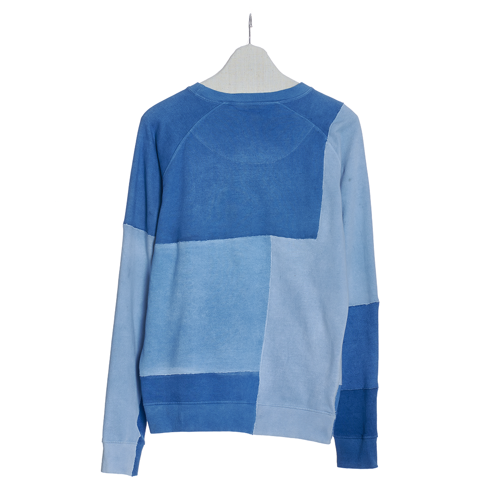 Back of mens lose fit patchwork sweatshirt in shade of indigo