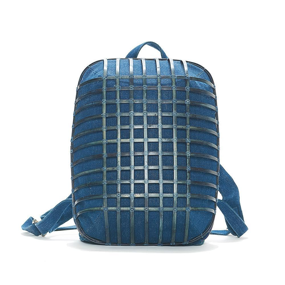 Indigo backpack with bamboo shell giving rounded structure.
