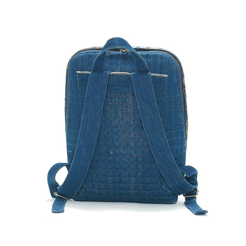 Padded reverse of indigo backpack showing adjustable straps.