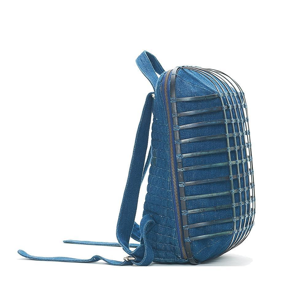 Side view of indigo backpack showing bamboo structure giving the backpack its structure.