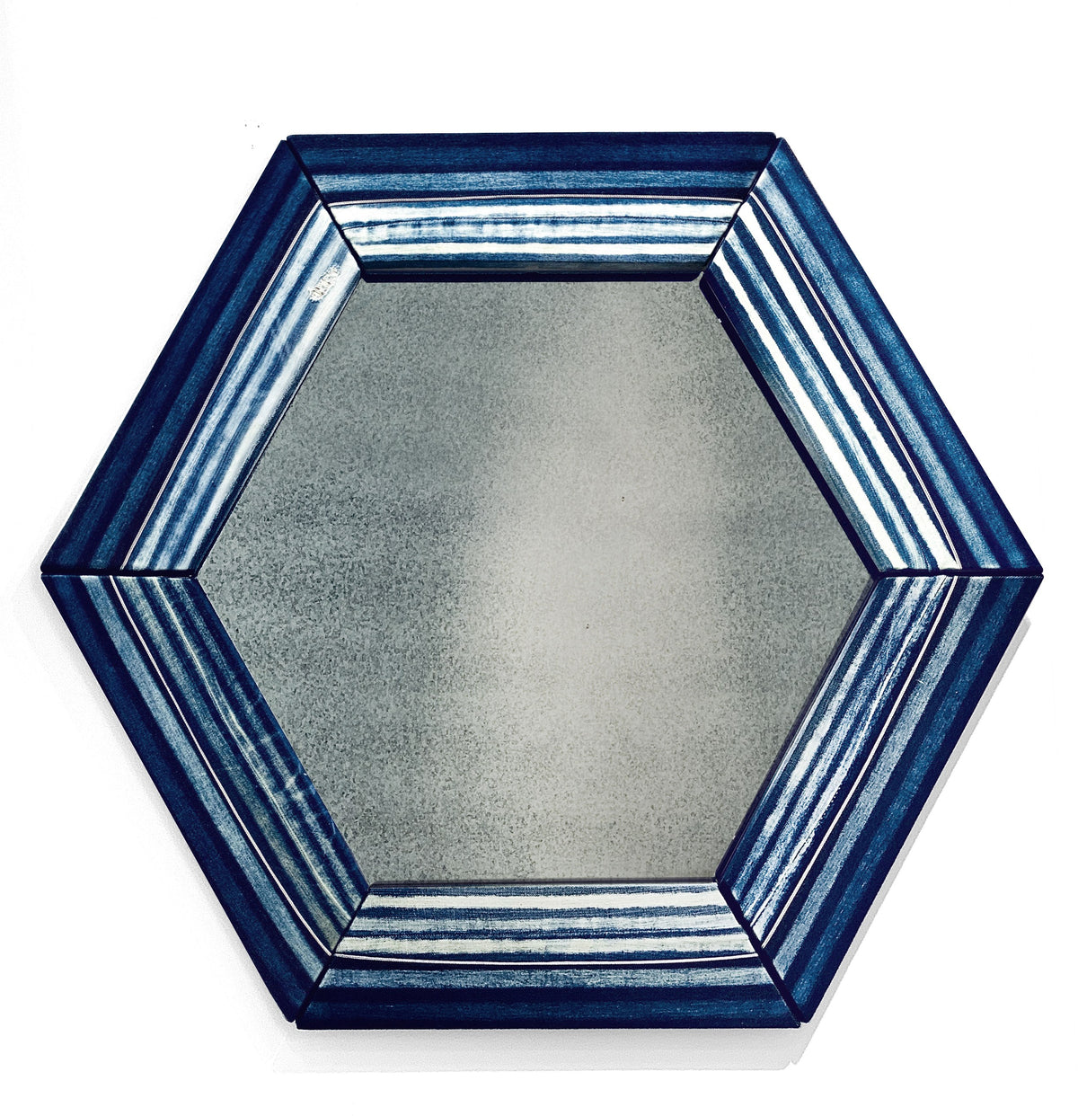 Hexagonal mirror with hand painted denim frame in varying striped of different shades