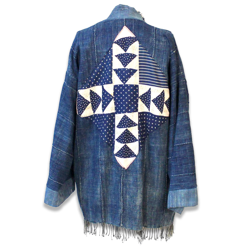 Antique quilt square on the reverse of indigo jacket made from vintage Mossi cloth from Burkina Faso, West Africa.