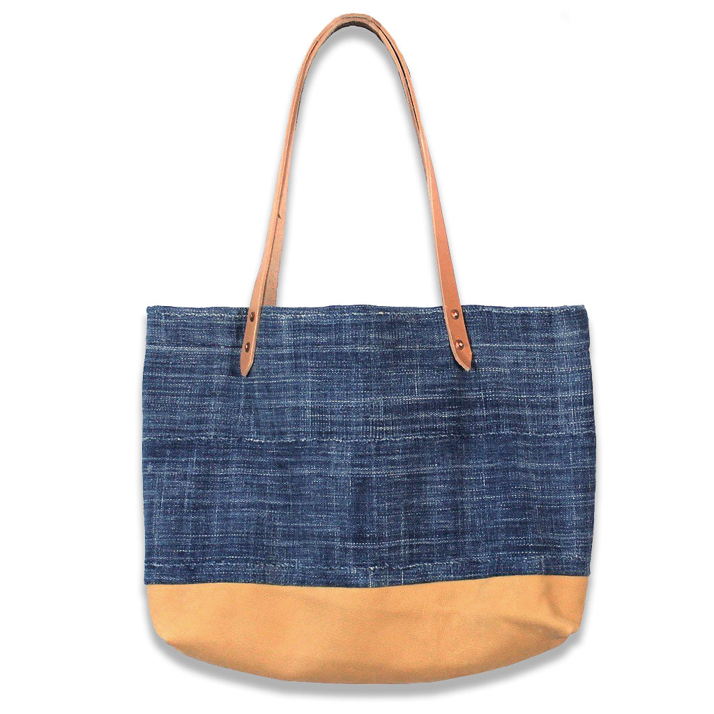 Indigo cloth tote bag with tan Deerskin leather straps and bottom.