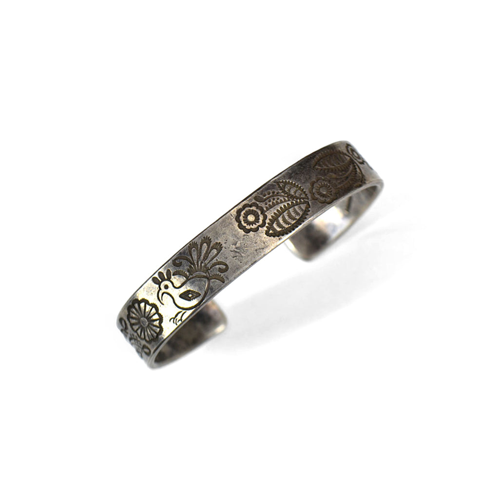 carved silver bracelet with flower and bird design