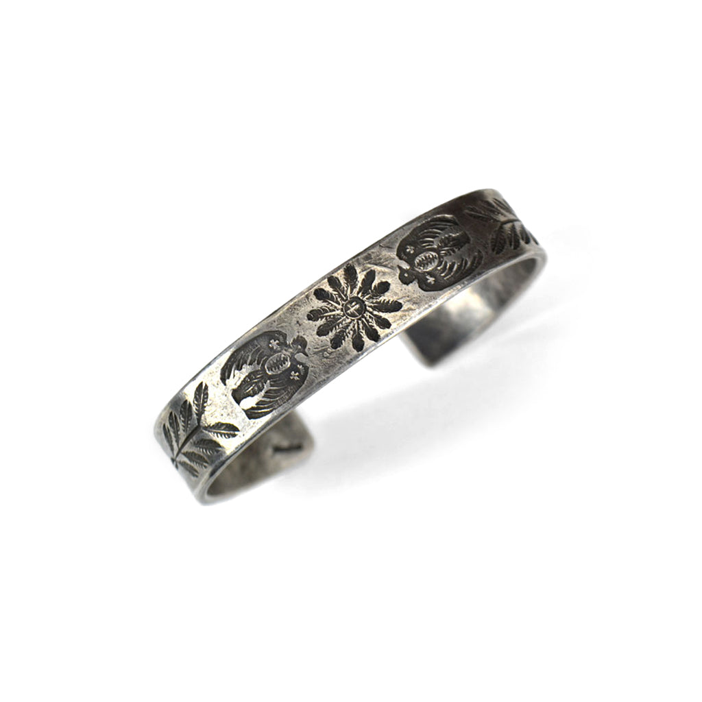 carved silver bracelet with flower and eagle bird desgn