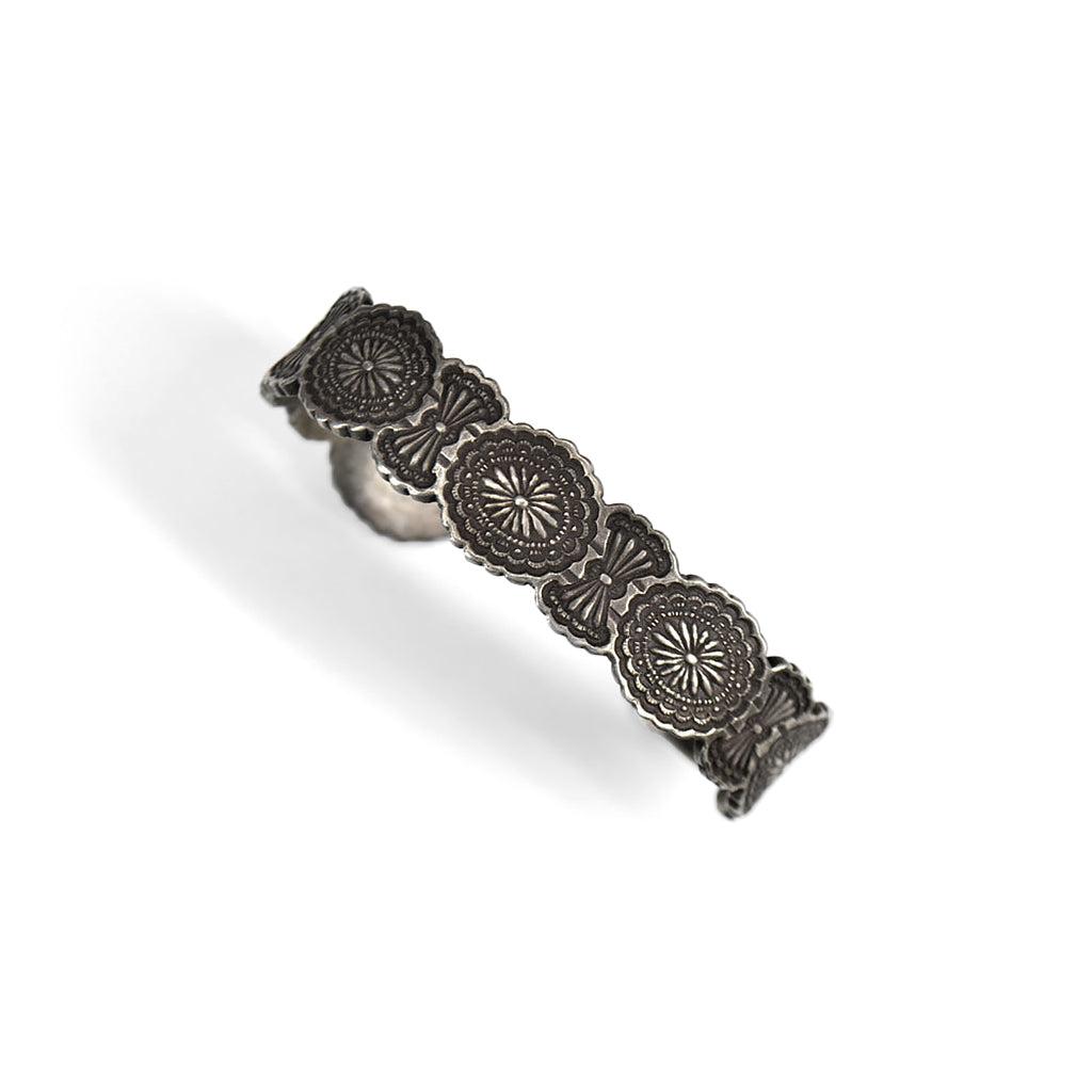 silver engraved bracelet to look like concho belt